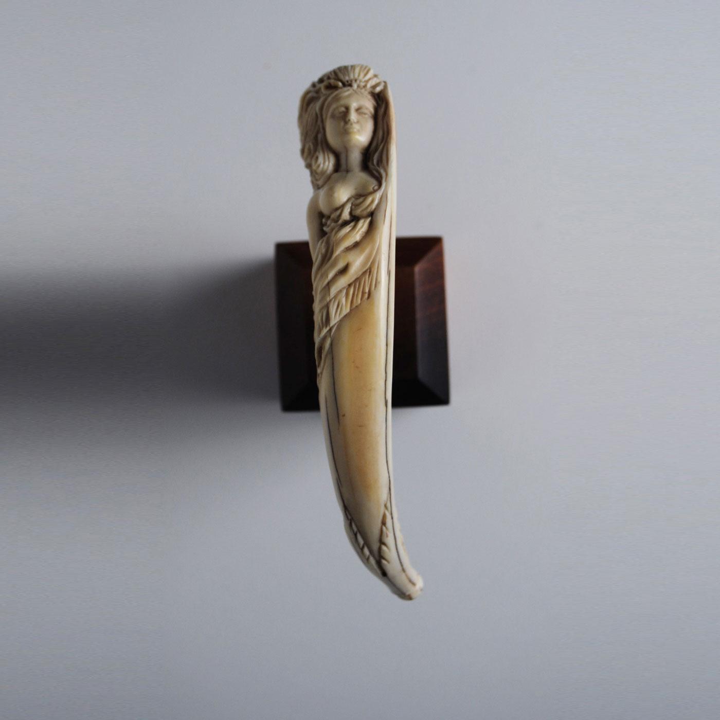 Whale bone carved into the mast head of a ship jeffrey