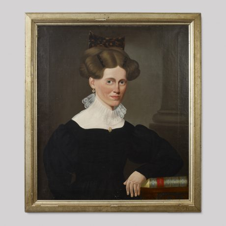 Portrait of a Woman Wearing a Tortoise Shell Comb Seated in a Chair Holding a Bo